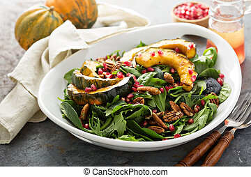 Fall salad with greens and acorn squash - Fall salad with...