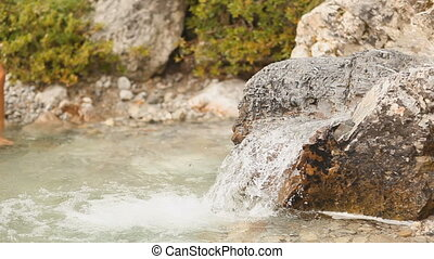 woman drinking water in stream