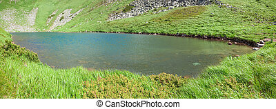 Alpine lake Brebeneckul on summer mountains (panorama) -...