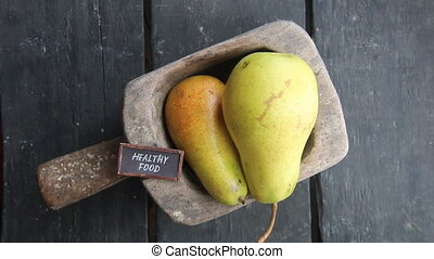 healthy food concept, pears on rustic background
