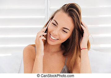 Close up portrait of girl in bikini talking on phone - Close...