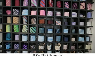 Ties at clothing store - Set of colorful ties on a shelves...