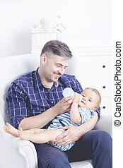Taking care of his baby brings him joy - Shot of a father...
