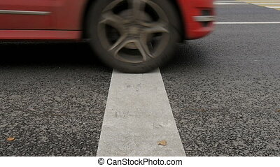 Cars cross the stop line. Slow motion