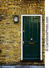 Typical British door with doorbell in West London.