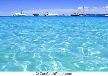 Illetes turquoise beach blue water Formentera boats horizon...