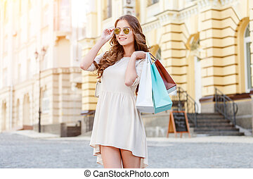 happy young woman with shopping bags - happy young caucasian...