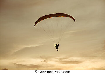 Paraglider flies on background of the sky sunset