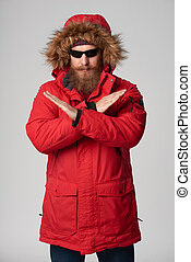 Man wearing red winter jacket gesturing stop enough hand...