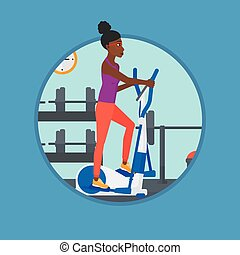 Woman exercising on elliptical trainer. - An...