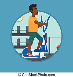 Man exercising on elliptical trainer. - An african-american...