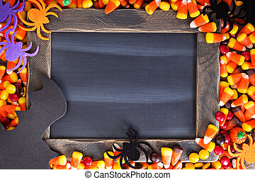 Halloween candy frame copy space with chalkboard