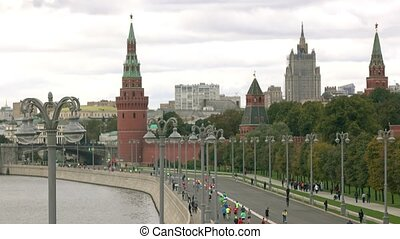Unrecognizable distant marathon runners near Moscow Kremlin....