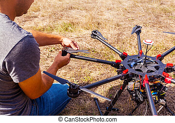 The process of setting up a copter before flight. The man...