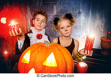 autumn holidays - Two cute children dressed as a vampire and...