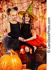 magic girls - Two cute little girl in halloween costumes...