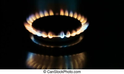 The burning torch on the gas stove,