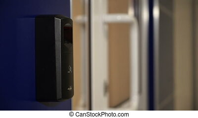 The door with the fingerprint scanner