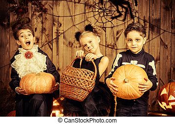trick-or-treating children - Group of joyful children in...