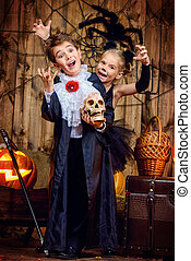 vampire and a black cat - Two funny children in halloween...