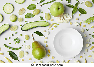 fresh organic green vegetables and fruits for salad - Close...