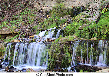 Springs - Water streams and cascade of the waterfalls
