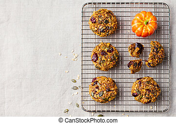 Oat cookies with cranberries and maple glaze on a colling...