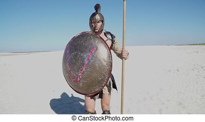 Warrior in the desert in the Middle Ages - Handsome muscular...