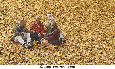 family taking a break in autumn part II - elderly parents...