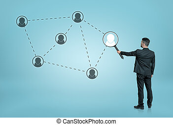 Businessman enlarging one of the social network icons...