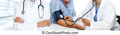Blood pressure measuring - Hands of medical doctor measuring...
