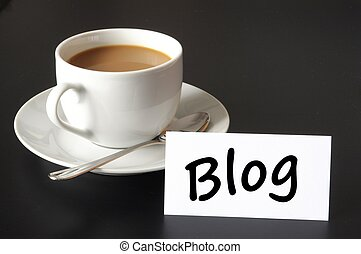 blog and cup of coffee with copyspace showing internet or...