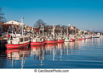 Fishing boats in Warnemuende (Germany) in Winter.