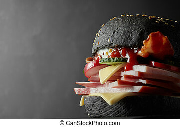 Japanese Black Burger with Cheese. Cheeseburger from Japan...