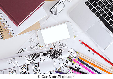 Business sketches and white cellphone - Top view of creative...