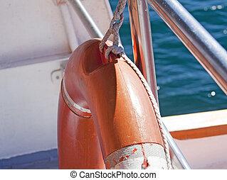 Life preserver - Orange Life preserver in a ship