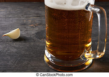 mug of beer on the table - glass of beer on a wooden table