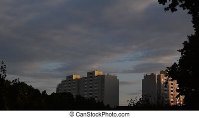 Time lapse of nightfall in a city. It gets dark. Clouds move...