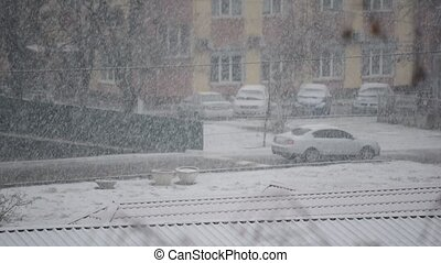 Heavy snow falling in city - Urban landscape with heavy snow...