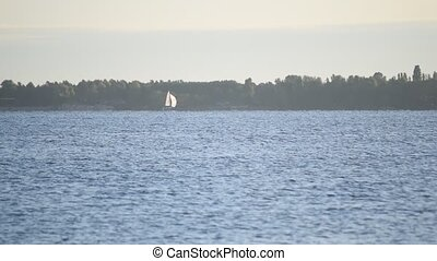 Sail boat on a lake or river - Sail boat far off on a lake...
