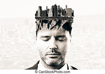 Thoughtful man with cityscape on head