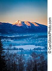 Sunrise in Zakopane with illuminated mountain by sun in...