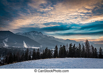 Zakopane during the skiing competitions in winter at sunset,...