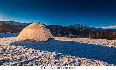 Tent on mountain top in winter in Zakopane, Tatra Mountains,...