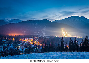 Skiing competitions in Zakopane at dusk in winter, Poland