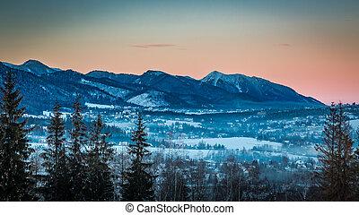 Illuminated peak by rays of sun in winter in Zakopane, Tatra...