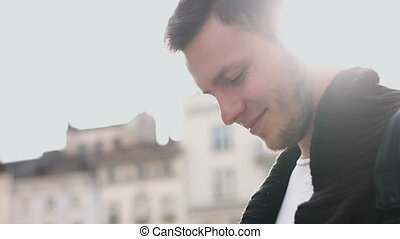Slow Motion Portrait of happy cute caucasian man smiling in...