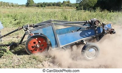 special equipment on a tractor for digging the potato -...