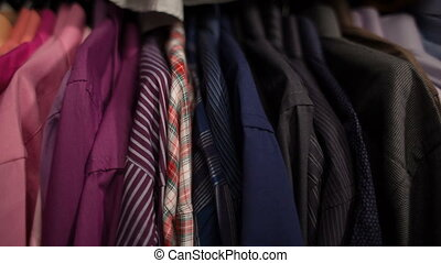 Men's shirts on hangers at store