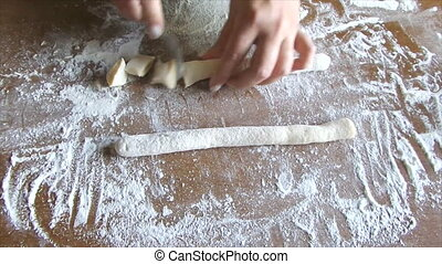 Making Potato Gnocchi - Woman hands making potato gnocchi on...